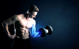 Fit athlete lifting weight with blue muscle light concept stock image