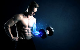 Fit athlete lifting weight with blue muscle light concept. On background Stock Image