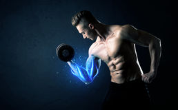 Fit athlete lifting weight with blue muscle light concept Royalty Free Stock Photos