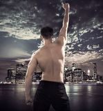 Fit athlete over the city background Stock Photos