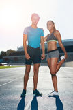 Fit athletes on race track Stock Image