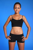 Fit athletic african american sports woman torso. Fit athletic torso of beautiful healthy young african american woman wearing black sports underwear, standing Royalty Free Stock Images