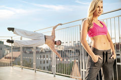 Fit and athletic couple duirng the training. Fit and athletic people duirng the training Stock Image