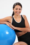 Fit athletic woman sitting with exercise ball Royalty Free Stock Photo