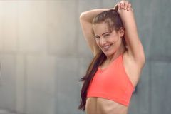 Fit athletic young woman with a happy smile Stock Images
