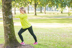 Fit attractive blonde stretching legs Stock Photo