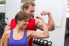 Fit attractive couple flexing their biceps Stock Images