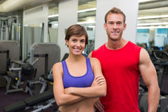 Fit attractive couple smiling at camera Royalty Free Stock Photo