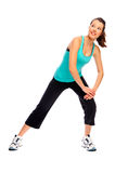 Fit attractive woman stretching Royalty Free Stock Photos