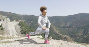 Fit beautiful female doing exercises Stock Image