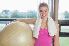 Fit beautiful woman carrying exercise ball Royalty Free Stock Photography