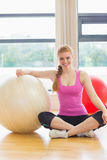 Fit beautiful woman with exercise ball in fitness studio Royalty Free Stock Photos