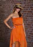 Fit beautiful woman in orange dress Stock Photo
