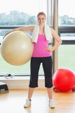 Fit beautiful young woman carrying exercise ball Royalty Free Stock Photography