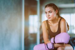 Fit beautiful young woman muay thai boxer exercise class in a gym. Healthy, sport, lifestyle, Fitness, workout concept. With copy. Space stock images