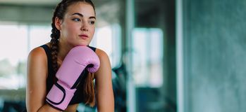 Fit beautiful young woman muay thai boxer exercise class in a gym. Healthy, sport, lifestyle, Fitness, workout concept. With copy. Space royalty free stock images