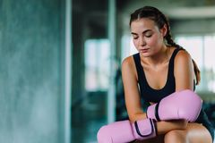 Fit beautiful young woman muay thai boxer exercise class in a gym. Healthy, sport, lifestyle, Fitness, workout concept. With copy. Space stock photo