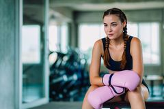 Fit beautiful young woman muay thai boxer exercise class in a gym. Healthy, sport, lifestyle, Fitness, workout concept. With copy. Space royalty free stock photos