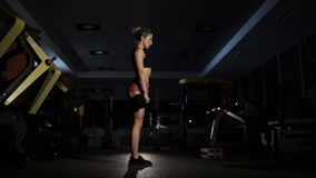 Fit beauty woman doing squat with dumbbell stock footage
