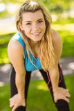 Fit blonde catching her breath Royalty Free Stock Photography