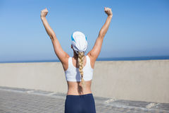 Fit blonde cheering on the pier Stock Images