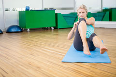 Fit blonde doing sitting up on mat Stock Photography