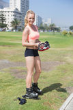 Fit blonde getting ready to roller blade Royalty Free Stock Photography