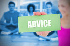 Fit blonde holding card saying advice Royalty Free Stock Image