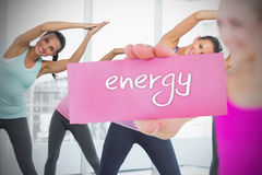 Fit blonde holding card saying energy Royalty Free Stock Photography
