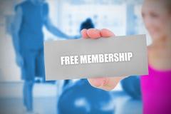 Fit blonde holding card saying free membership Royalty Free Stock Photo