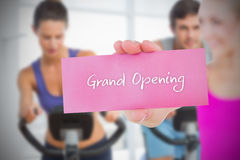 Fit blonde holding card saying grand opening Stock Photos