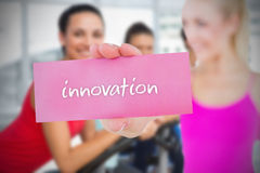 Fit blonde holding card saying innovation Stock Images