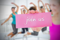 Fit blonde holding card saying join us Royalty Free Stock Photo