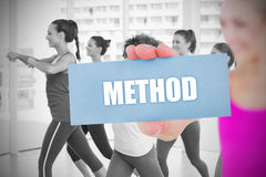 Fit blonde holding card saying method Stock Images