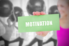 Fit blonde holding card saying motivation Stock Images