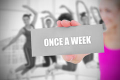 Fit blonde holding card saying once a week Royalty Free Stock Images