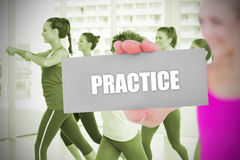 Fit blonde holding card saying practice Stock Images