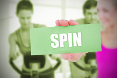 Fit blonde holding card saying spin Royalty Free Stock Photography