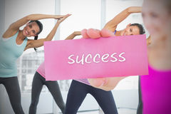 Fit blonde holding card saying success Royalty Free Stock Photo
