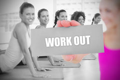 Fit blonde holding card saying work out Royalty Free Stock Photo
