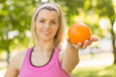 Fit blonde holding an orange Royalty Free Stock Photography