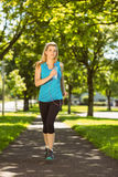 Fit blonde jogging in the park Stock Images