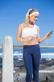 Fit blonde listening to music Stock Images