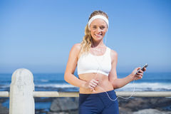 Fit blonde listening to music Stock Photos