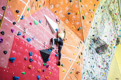 Fit blonde rock climbing indoors Royalty Free Stock Image