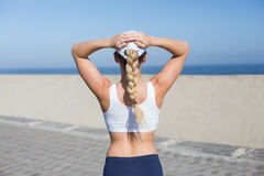 Fit blonde standing on the pier Royalty Free Stock Image