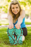 Fit blonde stretching on the grass Royalty Free Stock Images
