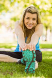 Fit blonde stretching on the grass Royalty Free Stock Image
