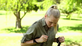 Fit blonde stretching before a hike stock footage