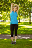 Fit blonde stretching in the park Stock Photos